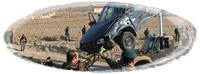 The wreckage of a car is removed from the site of a suicide attack in Kabul