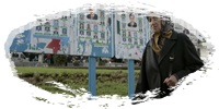 An Algerian women walks past municipal electoral posters in the Bologhine district of the Algiers City